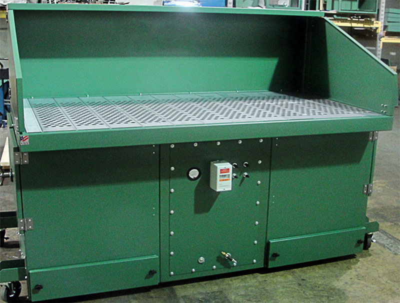 APB self-cleaning downdraft table in production facility