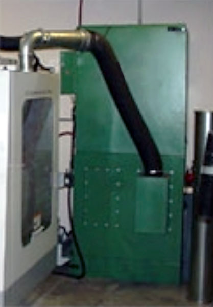 Vertical cartridge media collector ducted to CNC machine